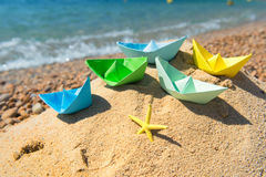 Paper boats at the beach Royalty Free Stock Photography