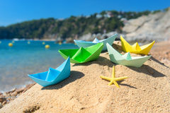 Paper boats at the beach Royalty Free Stock Photos