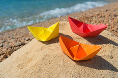 Paper boats at the beach. Paper boats in the sand at the beach Stock Image