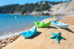 Paper boats at the beach Stock Photos