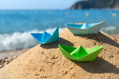 Paper boats at the beach. Paper boats in the sand at the beach Royalty Free Stock Photography