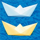 Paper boats in the blue paper sea Royalty Free Stock Photos