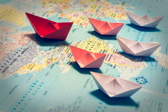 Paper Boats Following A Red Leader Boat Stock Image