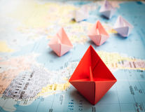 Free Paper Boats Following A Red Leader Boat Stock Images - 75031394