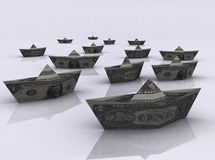 Paper boats made of dollar bills Stock Photos