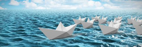 Composite image of paper boats made of origami. Paper boats made of origami against idyllic view of sea Stock Photos