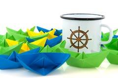 Paper boats and marine mug Stock Images