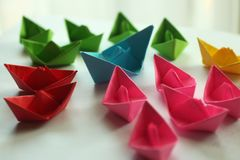 Paper boats. Origami colorful paper ships, stock image