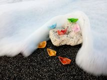 Paper boats on a rock stock photography