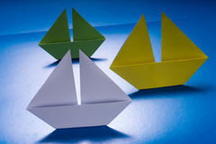 Paper Boats Sailing on Blue paper sea. Origami Ship Royalty Free Stock Images