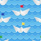 Paper boats sailing on blue paper water Royalty Free Stock Photo