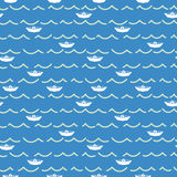 Paper boats and sea waves seamless pattern. Royalty Free Stock Images