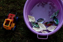 Paper boats and tractor stock images
