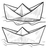 Paper boats vector. Doodle style origami folded paper boat floating on water in vector format Royalty Free Stock Images
