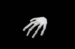 Paper bone hand. With black background Royalty Free Stock Images