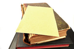 Paper on Book. Paper on Old style Book stock photos