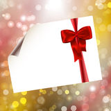 Paper with bow on bokeh lights abstract background Royalty Free Stock Photos