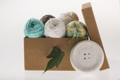 Paper box with colorful yarns Royalty Free Stock Image