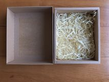 Paper box with shredded paper. Shredded paper for fragile protection Stock Photo
