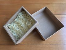 Paper box with shredded paper. Shredded paper for fragile protection Royalty Free Stock Photo