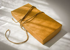 Paper box and string Stock Images