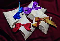 Paper boxes on maroon Royalty Free Stock Image