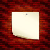 Paper on a brick wall Royalty Free Stock Photography