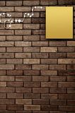 Paper on brick wall Stock Image
