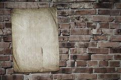 Paper on brickwall Stock Photos