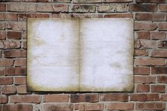Paper on brickwall Royalty Free Stock Image