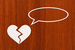Paper broken heart is talking or thinking. Abstract conceptual image Royalty Free Stock Images