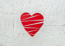 Paper broken heart on white wooden background Stock Images
