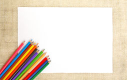 Paper on burlap with pencils Royalty Free Stock Photography