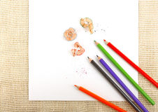 Paper on burlap with pencils Stock Photography