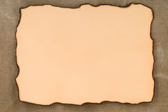 Paper with burn edges on canvas Royalty Free Stock Photography