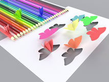 Paper butterflies flyand pencil Stock Photos