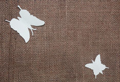 Paper butterflies on jute cloth Royalty Free Stock Images