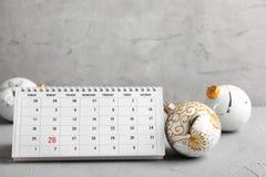 Paper calendar and decor on table. Christmas countdown. Paper calendar and festive decor on table. Christmas countdown stock photography