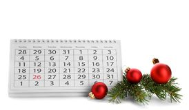 Paper calendar and decor on white background. Christmas countdown. Paper calendar and festive decor on white background. Christmas countdown royalty free stock images