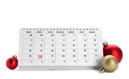 Paper calendar and decor on white background. Christmas countdown. Paper calendar and festive decor on white background. Christmas countdown stock photos