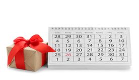 Paper calendar and gift on white background. Christmas countdown. Paper calendar and gift box on white background. Christmas countdown stock images