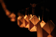 Paper candle light hanging on string. Night scene with paper candle lights hanged from sting Stock Photo