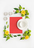 Paper, candles and cup for coffee or tea with wreath frame from Stock Photography