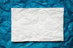 Paper card on blue background Stock Photos