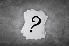 Paper card on a concrete table with question mark sign with free space. 3d rendering. Paper card on a concrete table with question mark sign with free space,3d Stock Photo