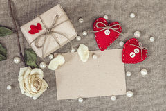 Paper card with gift box, white rose, heart and pearls beads Royalty Free Stock Photos
