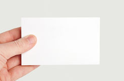 Paper card in hand. Paper white card in hand on backgraund stock photos