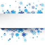 Paper card over blue snowflakes. Royalty Free Stock Image