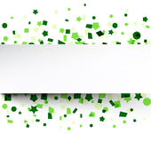 Paper card over green confetti. Stock Photos