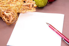 Paper card with pen. White paper empty card isolated on brown for christmas greetings Royalty Free Stock Photos